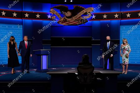 From l-r., first lady Melania Trump, President Donald Trump, moderator Kristen Welker of NBC News, Democratic presidential candidate former Vice President Joe Biden and his wife Jill Biden on stage at the conclusion of the second and final presidential debate, at Belmont University in Nashville, Tenn
