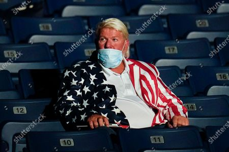 Golfer John Daly takes his seat ahed of the second and final presidential debate, at Belmont University in Nashville, Tenn