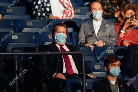 Tony Bobulinski, center seated, who says he is a former associate of Hunter Biden, waits for the start of the second and final presidential debate, at Belmont University in Nashville, Tenn
