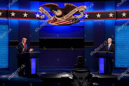 President Donald Trump, left, and Democratic presidential candidate former Vice President Joe Biden, left, during the second and final presidential debate, at Belmont University in Nashville, Tenn. Seated in the center is moderator Kristen Welker of NBC News
