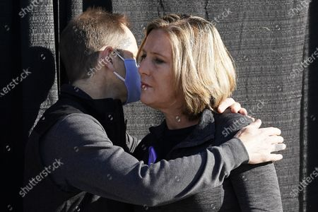 Jill and Matt McCluskey, the parents of slain University of Utah student-athlete Lauren McCluskey hug during a press conference announcing they have reached a settlement in their lawsuit against the University of Utah, in Salt Lake City