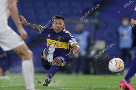Carlos Tevez of Argentina's Boca Juniors connects a shot during a Copa Libertadores Group H soccer match against Venezuela's Caracas FC at the Bombonera stadium in Buenos Aires, Argentina
