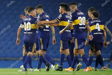 Carlos Tevez of Argentina's Boca Juniors (10) celebrates with teammates after scoring his side's third goal against Venezuela's Caracas FC during a Copa Libertadores Group H soccer match at the Bombonera stadium in Buenos Aires, Argentina