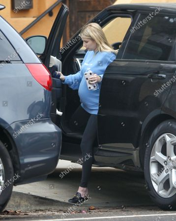Emma Roberts steps out of her car in comfortable attire