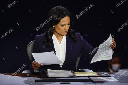 Moderator Kristen Welker of NBC News looks at papers as President Donald Trump and Democratic presidential candidate former Vice President Joe Biden participate in the final presidential debate at Belmont University, in Nashville, Tenn