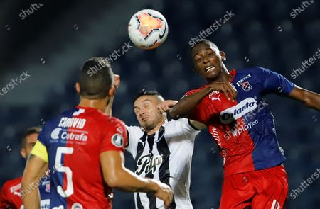 Stock Picture of Libertad's Adrian Martinez (C) in action against Deportivo Independiente Medellin's Yesid Diaz (R) during a match for Group H of the 2020 Copa Libertadores, at the General Pablo Rojas stadium in Asuncion, Paraguay, 22 October 2020.