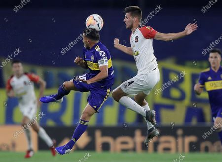 Carlos Tevez (L) of Boca Juniors in action against Diego Osio (R) of Caracas FC during the Copa Libertadores group H soccer match between Boca Juniors and Caracas FC at La Bombonera Stadium in Buenos Aires, Argentina, 22 October 2020.