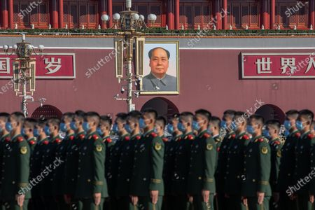 Chinese paramilitary police officers stand in front of the Chairman Mao portrait on the south gate of the Forbidden City as they wait to attend the event at the Great Hall of the People marking the 70th anniversary of China's entry into the Korean war, in Beijing, China, 23 October 2020.