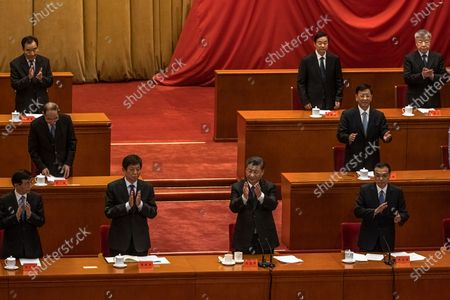 Chinese President Xi Jinping (C) and Premier Li Keqiang (R) applaud during the conference marking the 70th anniversary of China's entry into the Korean war, at the Great Hall of the People, in Beijing, China, 23 October 2020.