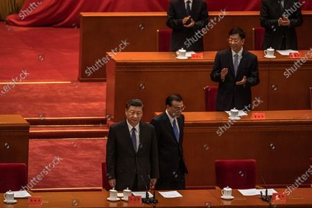 Chinese President Xi Jinping (C) and Premier Li Keqiang (C-R) arrive at the event marking the 70th anniversary of China's entry into the Korean war, at the Great Hall of the People, in Beijing, China, 23 October 2020.