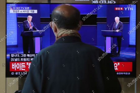 "Man watches a TV screen showing a live broadcast of U.S. President Donald Trump, left, and Democratic presidential candidate former Vice President Joe Biden during the final presidential debate, at the Seoul Railway Station in Seoul, South Korea, . The Korean letters read ""U.S. presidential election TV debate"