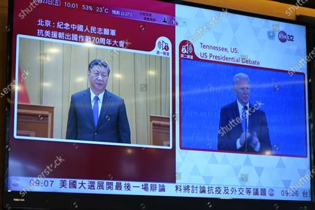 Screen broadcasts Chinese President Xi Jinpin speaking at a commemorating conference on the 70th anniversary of China's entry into the 1950-53 Korean War, left, and U.S. Democratic presidential candidate former Vice President Joe Biden speaking at the U.S. presidential debate, right, at a restaurant in Hong Kong