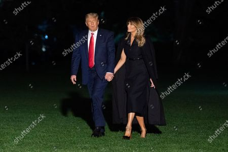 US President Donald J. Trump (L) and First Lady Melania Trump (R) arrive at the White House in Washington, DC, USA, 23 October 2020. The presidential couple came back from the final presidential debate between Trump and Democratic presidential candidate Joe Biden in Nashville, Tennessee. The United States will hold its presidential election on 03 November.