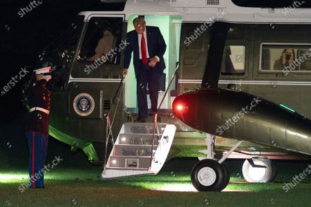 US President Donald J. Trump (C) disembarks Marine One as he arrives at the White House in Washington, DC, USA, 23 October 2020. Trump came back from the final presidential debate with Democratic presidential candidate Joe Biden in Nashville, Tennessee. The United States will hold its presidential election on 03 November.