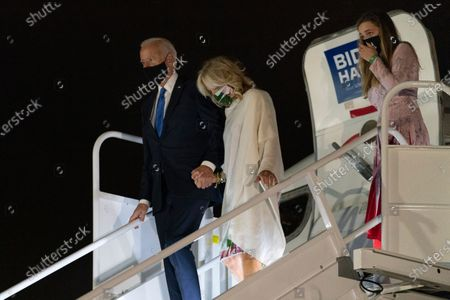Democratic candidate former Vice President Joe Biden, his wife Jill Biden and granddaughter Finnegan Biden arrive at New Castle Airport in New Castle, Del., as he returns from Nashville, Tenn., after the final presidential debate against Republican candidate President Donald Trump