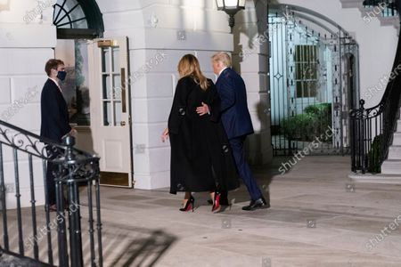 United States President Donald J. Trump and First lady Melania Trump arrive at the White House, in Washington, DC as they return from Nashville, Tennessee where he participated in a debate with the Democratic presidential candidate, former US Vice President Joe Biden.
