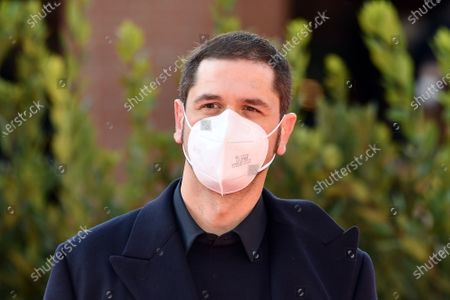 Director Gabriele Mainetti with face mask
