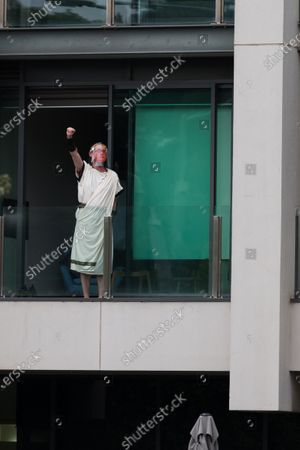 Stock Photo of A man dressed up as Julius Caesar with a Daniel Andrews mask on is seen on his balcony during the Melbourne Freedom Rally at The Shrine. Premier Daniel Andrews promises 'significant' easing of Stage 4 restrictions this weekend. This comes as only one new case of Coronavirus was unearthed over the past 24 hour and no deaths.