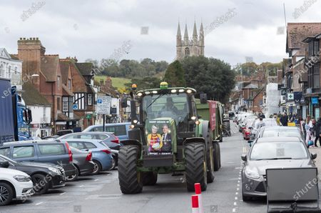 ; Marlborough, UK. Save British Farming protest with tractors through the centre of Marlborough campaigning to maintain food standards which are under threat from a post-Brexit trade deal with the USA. There's a family stand off with local MP for Devizes, Danny Kruger, who rejected the Lords' amendments to the Agriculture Bill to maintain food and environmental standards. But his mother the famous cook Prue Leith is asking to keep those standards and Save British Farming want his mother to win this argument with the aid of tractors.