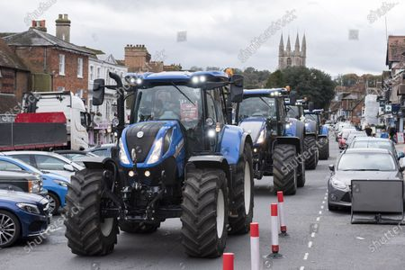 ; Marlborough, UK. A Save British Farming protest with tractors through the centre of Marlborough campaigning to maintain food standards which are under threat from a post-Brexit trade deal with the USA. There's a family stand off with local MP for Devizes, Danny Kruger, who rejected the Lords' amendments to the Agriculture Bill to maintain food and environmental standards. But his mother the famous cook Prue Leith is asking to keep those standards and Save British Farming want his mother to win this argument with the aid of tractors.