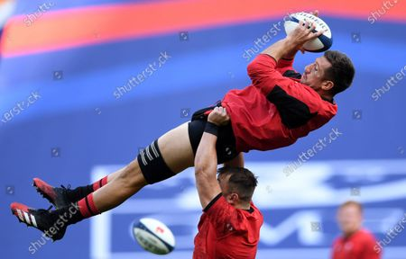 Justin Tipuric is lifted by Sam Parry during training.