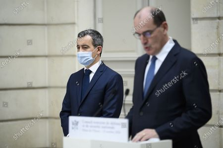 French Prime Minister Jean Castex, with French interior Minister Gerald Darmanin, delivers a speech during a press conference after Defense Council at Elysee Palace, in Paris, on October 23, 2020.