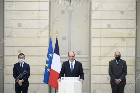 French Prime Minister Jean Castex, with French interior Minister Gerald Darmanin and French justice Minister Eric Dupond Moretti, delivers a speech during a press conference after Defense Council at Elysee Palace, in Paris, on October 23, 2020.