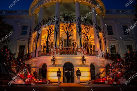 President Donald Trump and first lady Melania Trump depart after giving candy to children during a Halloween trick-or-treat event on the South Lawn of the White House in Washington, which is decorated for Halloween. Melania Trump announced Friday that ghosts and goblins are welcome to trick or treat at the White House on Sunday during a Halloween event that has been rejiggered to include coronavirus precautions. President Donald Trump and the first lady - both recently recovered from COVID-19, the disease brought on by the coronavirus - will welcome guests