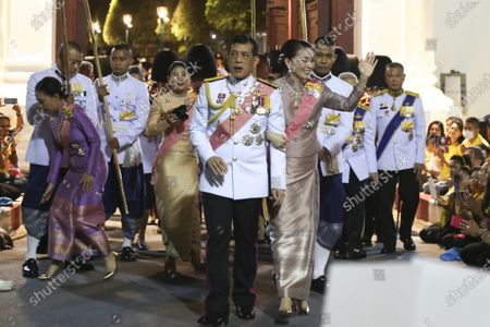 Stock Picture of Thai King Maha Vajiralongkorn Bodindradebayavarangkun (C) and Thai Queen Suthida (C-R) walk with Princess Bajrakitiyabha Mahidol (L) and Princess Sirivannavari Nariratana (2-L) as they greet supporters outside the Grand Palace after a Buddhist ceremony for late King Chulalongkorn, or King Rama V, in Bangkok, Thailand, 23 October 2020. The date, 23 October, marks the anniversary of the death of Thai King Chulalongkorn, who passed away in 1910.