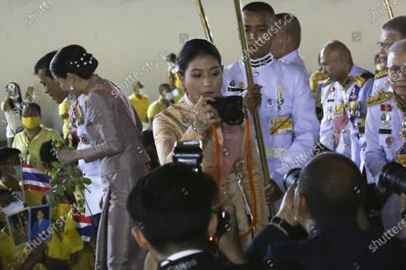 Thai Princess Sirivannavari Nariratana (C) takes pictures as Thai King Maha Vajiralongkorn Bodindradebayavarangkun (L) and Thai Queen Suthida (2-L) greet supporters outside the Grand Palace after a Buddhist ceremony for late King Chulalongkorn, or King Rama V, in Bangkok, Thailand, 23 October 2020. The date, 23 October, marks the anniversary of the death of Thai King Chulalongkorn, who passed away in 1910.