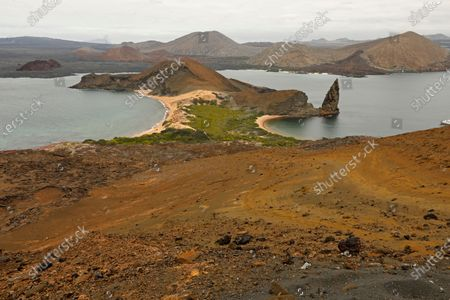 Stock Image of Pinnacle Rock, to the right, is a celebrated volcanic plug on Bartolome Island, one of Ecuador's Galapagos Islands.The Galapagos Islands are the breeding ground for many species on land and in the sea. (Carolyn Cole/Los Angeles Times)