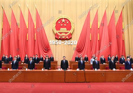 Xi Jinping, Li Keqiang, Li Zhanshu, Wang Yang, Wang Huning, Zhao Leji, Han Zheng and Wang Qishan attend a meeting marking the 70th anniversary of the Chinese People's Volunteers entering the Democratic People's Republic of Korea to fight in the War to Resist U.S. Aggression and Aid Korea, at the Great Hall of the People in Beijing, capital of China, Oct. 23, 2020.