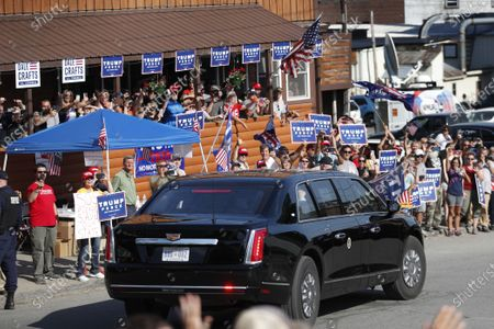 Supporters of President Donald Trump cheer as the motorcade passes during Trump's visit to Guilford, Maine. Trump visited Puritan Medical Products, one of the top two makers of testing swabs in the world. Nebraska and Maine aren't exactly swing states in the race to pick the next president, but each one has something to offer next month that could give them a huge amount of sway: a single electoral vote