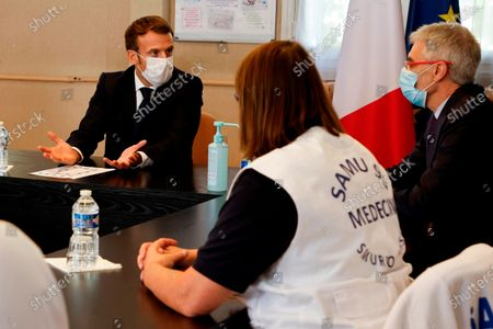 """French President Emmanuel Macron, left, chairs a meeting with the medical staff of the Rene Dubos hospital center, in Pontoise, outside Paris, . French Prime Minister Jean Castex said Thursday a vast extension of the nightly curfew that is intended to curb the spiraling spread of the coronavirus, saying """"the second wave is here."""" The curfew imposed in eight regions of France last week, including Paris and its suburbs, is being extended to 38 more regions and Polynesia"""