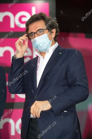 Italian businessman Urbano Cairo, president of the RCS Media Group, wears a protective face mask during the podium ceremony the 19th stage of the 2020 Giro d'Italia cycling race over 124.5km from Abbiategrasso to Asti, Italy, 23 October 2020. The weather conditions led to a protest of the riders resulting in a reduction of the route scheduled for the 19th stage.