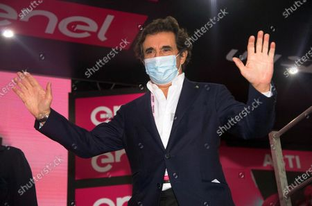 Stock Image of Italian businessman Urbano Cairo, president of the RCS Media Group, wears a protective face mask during the podium ceremony the 19th stage of the 2020 Giro d'Italia cycling race over 124.5km from Abbiategrasso to Asti, Italy, 23 October 2020. The weather conditions led to a protest of the riders resulting in a reduction of the route scheduled for the 19th stage.