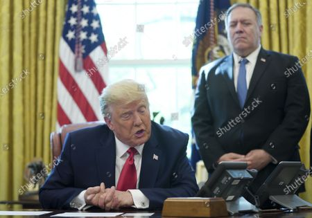 US President Donald J. Trump (L) speaks on a conference call with leaders of Israel and Sudan and to members of the media about a Sudan-Israel peace agreement at the White House in Washington, DC, USA, on 23 October 2020 US Secretary of State Michael Pompeo (R) look on. President Trump announced that Israel and Sudan will start to normalize ties.