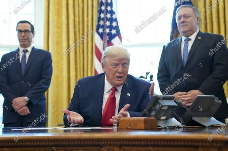 US President Donald J. Trump (C) speaks on a conference call with leaders of Israel and Sudan and to members of the media about a Sudan-Israel peace agreement at the White House in Washington, DC, USA, on 23 October 2020 as US Secretary of State Michael Pompeo (R) and US Treasury Secretary Steve Mnuchin (L) look on. President Trump announced that Israel and Sudan will start to normalize ties.