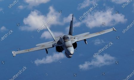 A Spanish Air Forces F-18 aircraft takes part in a joint military exercise over the Canary Islands, Spain, 23 October 2020.