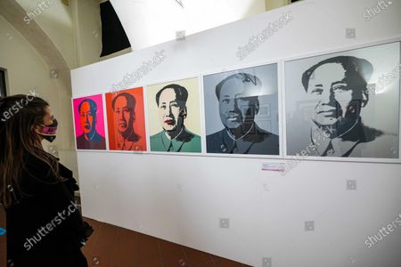 A visitor takes pictures of portraits of the Chinese Communist leader Mao by US artist Andy Warhol are on display in the Andy Warhol exhibition, entitled 'Super Pop,' in Nichelino, near Turin, Italy, 23 October 2020. The exhibit runs at the Palazzina di caccia of Stupinigi from 24 October 2020 to 31 January 2021.