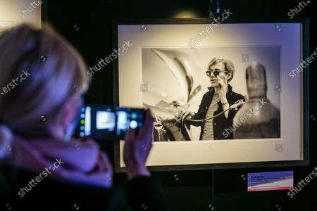 A visitor takes pictures of a portrait of US artist Andy Warhol by US photographer Fred W. McDarrah, on display in the Andy Warhol exhibition, entitled 'Super Pop,' in Nichelino, near Turin, Italy, 23 October 2020. The exhibit runs at the Palazzina di caccia of Stupinigi from 24 October 2020 to 31 January 2021.