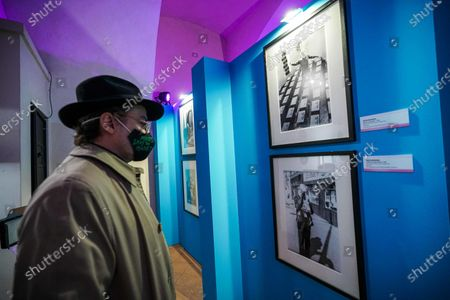 A visitor looks at portraits of US artist Andy Warhol by US photographer Fred W. McDarrah, on display in the Andy Warhol exhibition, entitled 'Super Pop,' in Nichelino, near Turin, Italy, 23 October 2020. The exhibit runs at the Palazzina di caccia of Stupinigi from 24 October 2020 to 31 January 2021.