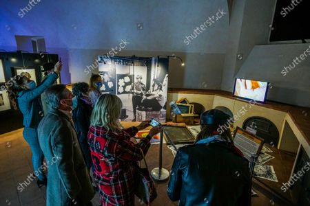 People visit the Andy Warhol exhibition, entitled 'Super Pop,' in Nichelino, near Turin, Italy, 23 October 2020. The exhibit dedicated to US artist Andy Warhol runs at the Palazzina di caccia of Stupinigi from 24 October 2020 to 31 January 2021.