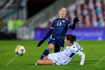 Albina Rrahmani (#4) of Albania slides in to in the ball from Jane Ross (#13) of Scotland during the UEFA Womens European Championship Qualifier match between Scotland Women and Albania Women at Tynecastle Stadium, Gorgie