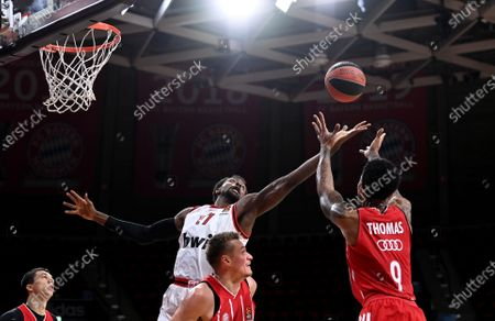 Stock Photo of Olympiacos' Livio Jean-Charles (C) in action against Munich's Malcolm Thomas (R) during the Euroleague basketball match between Bayern Munich and Olympiacos Piraeus in Munich, Germany, 23 October 2020.
