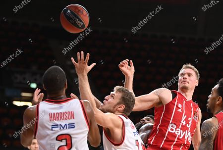 Olympiacos players Aaron Harrison (L) and Sasha Vezenkov (2-L) in action against Munich players Leon Radosevic (2-R) and Malcolm Thomas (R) during the Euroleague basketball match between Bayern Munich and Olympiacos Piraeus in Munich, Germany, 23 October 2020.