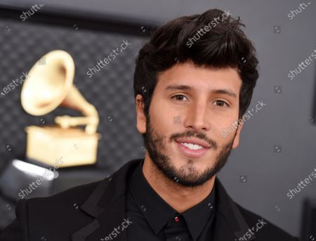 Stock Photo of Sebastian Yatra arrives at the 62nd annual Grammy Awards at the Staples Center, in Los Angeles. Yatra has collaborated with artists such as Jonas Brothers, One Republic and Michael Buble, but he doesn't feel entirely satisfied with his work. In a recent interview with the Associated Press, the Colombian musician relays what advantages the pandemic has given him to perfect his art, taking daily guitar classes