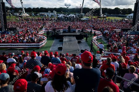 President Donald Trump speaks during a campaign rally at The Villages Polo Club, in The Villages, Fla