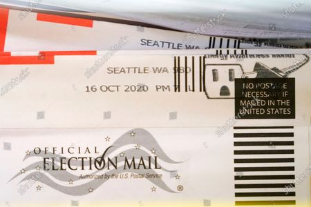 Postmarked vote-by-mail ballot is shown at the King County election headquarters in Renton, Wash., . Washington is a vote by mail state, and thousands of ballots have already been mailed back, dropped off in boxes, or cast in person. Although counting has begun, no results will be known to workers or released until the night of election day