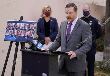Bureau of Alcohol, Tobacco, Firearms and Explosives Assistant Special Agent in Charge Brian Ingargiola of the Central California District's national security division, talks to reporters next to portraits of the 14 victims in a 2015 terror attack in San Bernardino, Calif., outside federal court in Riverside, Calif., . Enrique Marquez Jr. was sentenced to 20 years in prison Friday for supplying the rifles used by his friend Syed Rizwan Farook and Farook's wife to open fire on a gathering of Farook's co-workers from San Bernardino County nearly five years ago. After killing 14 people and wounding 22, Farook and his wife were killed in a gun battle with authorities